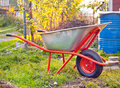 Garden wheelbarrow full of humus soil Royalty Free Stock Photos