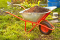 Garden wheelbarrow full of humus soil Stock Images