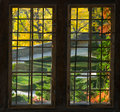 A garden through a window ksksiaz castle looking at the in autumn Stock Image