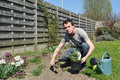 Garden work at spring young man working in the time Stock Photography