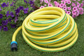 Garden yellow plastic hose-pipe Royalty Free Stock Photo