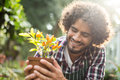 Gardener holding potted plant outside greenhouse Royalty Free Stock Photo