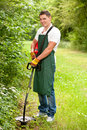 Gardener with lawn trimmer Royalty Free Stock Photo