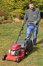 Gardener with lawnmower Stock Photography