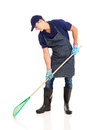 Gardener raking professional young on white background Royalty Free Stock Photography