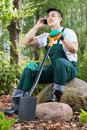 Gardener resting talking on the phone young asian Royalty Free Stock Photos