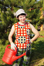 Gardener with a watering can Royalty Free Stock Photo