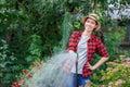 Gardener watering garden
