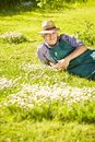 Gardeners lying meadow flowers mouth Royalty Free Stock Photo