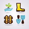 Gardening concept gumboots fence plant and tools Stock Image