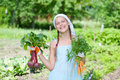 Gardening girl vegetable garden little gardener with bunch of organic carrots and beets Royalty Free Stock Image