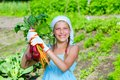 Gardening girl vegetable garden little gardener with bunch of organic carrots and beets Stock Photo