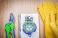 Gardening safety gloves garden pruner soft wire tie copybook on Royalty Free Stock Photo