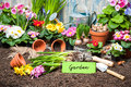 Gardening sign and flowers tools in the garden Royalty Free Stock Images