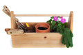 Gardening supplies including pots, flowers and tools