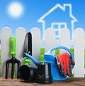 Gardening tools on a background of clouds house Stock Photography