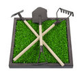 Gardening Tools on a Bed of Raised Grass Royalty Free Stock Photography