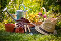 Gardening tools and a straw hat on the grass in the garden Royalty Free Stock Photos