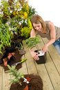 Gardening - woman with bonsai tree and plants Royalty Free Stock Image