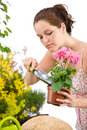 Gardening - woman holding flower pot and shovel Stock Image