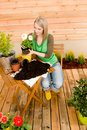 Gardening woman planting spring flower Stock Images