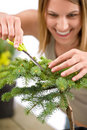 Gardening - woman trimming spruce tree Royalty Free Stock Photo