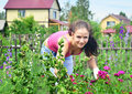 Gardening young beautiful woman working in her garden Stock Photo