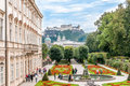 Gardens in mirabell palace salzburg with fortress Stock Images