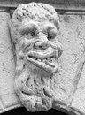 Gargoyle carving of a adorns the wall of santa maria formosa venice italy Royalty Free Stock Images