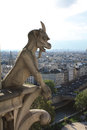 Gargoyle chimera on notre dame de paris Stock Photo