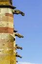 Gargoyle on a gothic cathedral detail of a tower on blue sky ba background saint florent church niederhaslach france Stock Photos