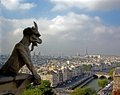 Gargoyle overlooking paris on the top of notre dame cathedral the city with the seine river and the eiffel tower Stock Photography
