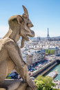 Gargoyle paris stryge and demon at notre dame of overlooking the skyline at a summer day selectice focus at Stock Photo