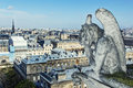 Gargoyle of the roof of cathedral notre dame paris wit architectural fragment in foreground taken from Royalty Free Stock Image