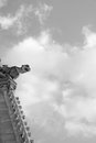 Gargoyle in the sky notre dame black and white shot from below Royalty Free Stock Image