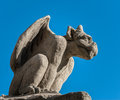 Gargoyle stone isolated against a blue sky Royalty Free Stock Photos