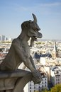 Gargoyle and view from Notre Dame de Paris Stock Photography