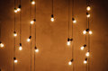 Garland of edison lamps on a wooden backgroundn Royalty Free Stock Photo