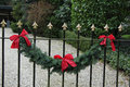 Garland on a fence classic steel decorated with traditional christmas Royalty Free Stock Image