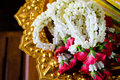 Garland jasmine rose flowers golden tray Stock Image