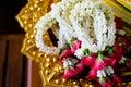Garland jasmine rose flowers golden tray Stock Image