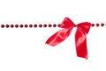 Garland red beads with bow isolated on white background Stock Photos