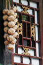 Garlic on the ancient window. Royalty Free Stock Photo