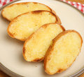Garlic bread homemade crusty on plate Stock Photography