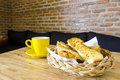 Garlic bread served in basket with cup of coffee Royalty Free Stock Photo