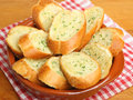 Garlic bread in terracotta dish Royalty Free Stock Image