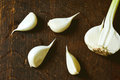 A garlic bulb broken cloves of on wooden background Stock Image
