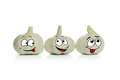Garlic cartoon characters three lovely in a low Royalty Free Stock Image