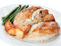 Garlic chicken with green beans and roast potatoes Royalty Free Stock Photography