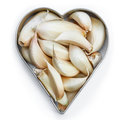 Garlic cloves in heart shape Royalty Free Stock Images